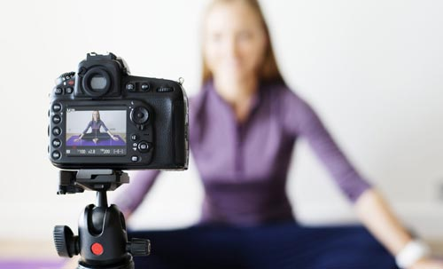 Woman in front of camera using micro influencer marketing software