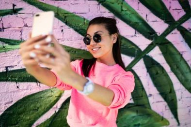 Woman in front of wall showing what is a micro influencer